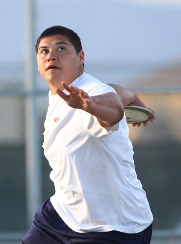 Liberty senior Reno Tu'ufuli, shown practicing Tuesday, has the third-best discus throw in ...