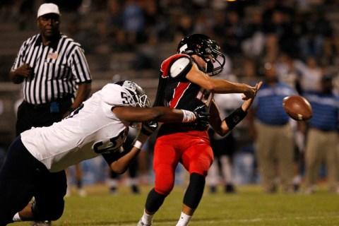 Centennial defensive lineman Greg Rogers tackles Las Vegas quarterback Trevor Swenson on Sat ...