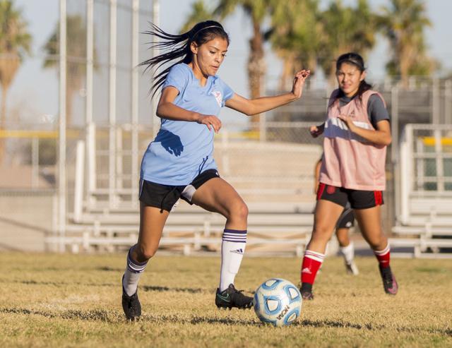 Western Warrior girls soccer midfielder and captain Kirsten Molinaruns, senior, left, run w ...