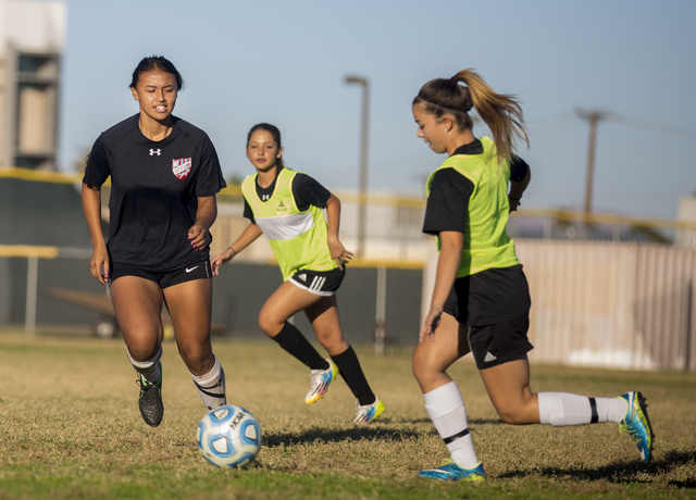 Western Warrior girls soccer midfielder Ellyson Reynada, senior, left, runs with the ball d ...