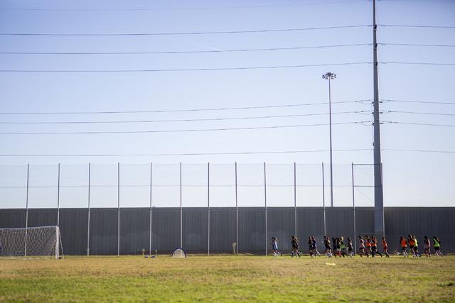 The Western Warriors girls soccer team run laps before practice at Western High School, Wedn ...