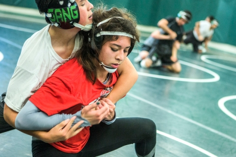 Leiana Nacapuy, in red, a Junior Women's Freestyle Nationals All-American, goes throug ...