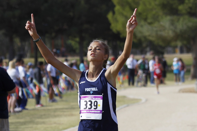 Foothill's Karina Haymore raises her arms while crossing the finish line during the Su ...