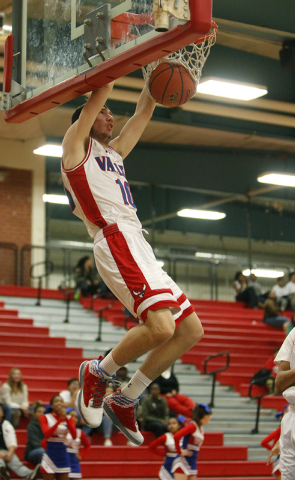 Valley's Spencer Mathis dunks the ball during a game against Coronado on Wednesday.