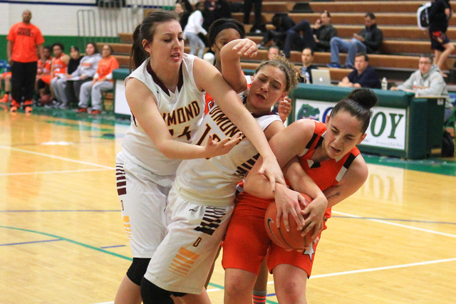 Dimond center Lexi Wingert, left, and guard Lauren Hines fight for a loose ball with Chaparr ...