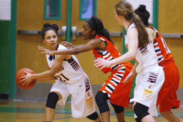Chaparral guard Taij Criss-Felton defends Dimond guard Shameah Jones (21) during their game ...