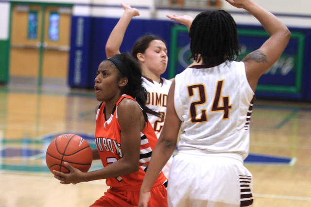 Chaparral guard Taij Criss-Felton drives between Dimond guards Tiffany Jackson and Dejha Can ...