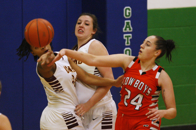 Chaparral guard Alexis Vanstory swats the ball away from Dimond guard Dejha Canty during the ...