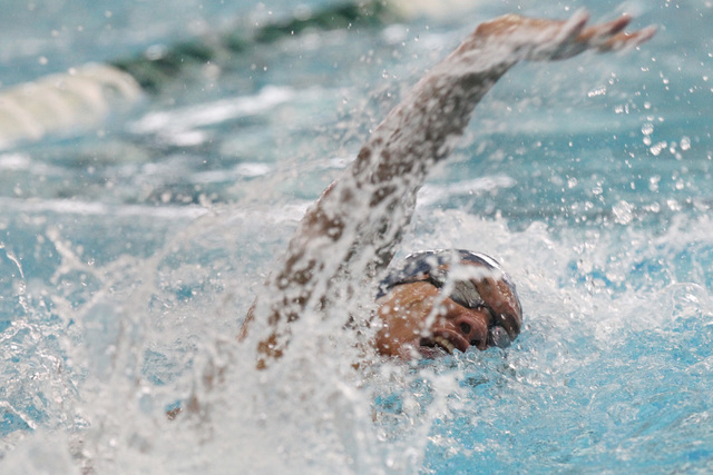 Legacy swimmer Isiah Magsino swims the anchor leg of the 400 freestyle relay during a meet S ...