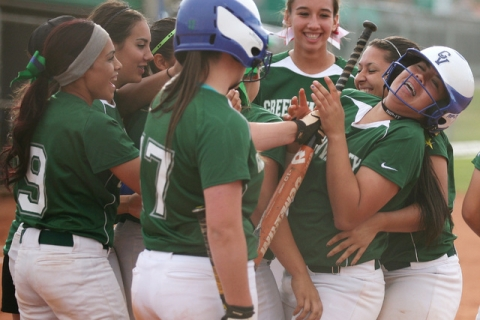Green Valley's Samantha Loving, far right, is swarmed by teammates after hitting a hom ...