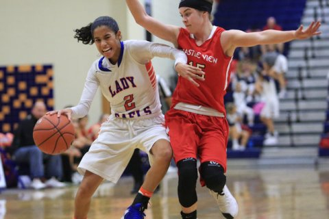 Bishop Gorman sophomore Shaira Young (2) dribbles the ball past a defender during the Las Ve ...