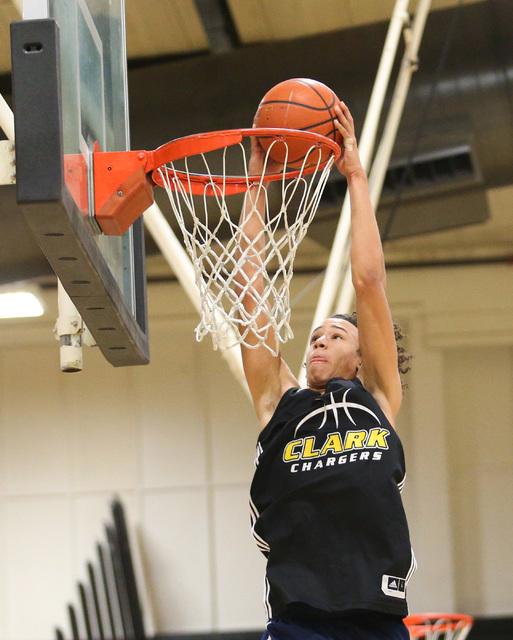 Clark forward Ian Alexander dunks the ball during practice at Ed W. Clark High School in Las ...