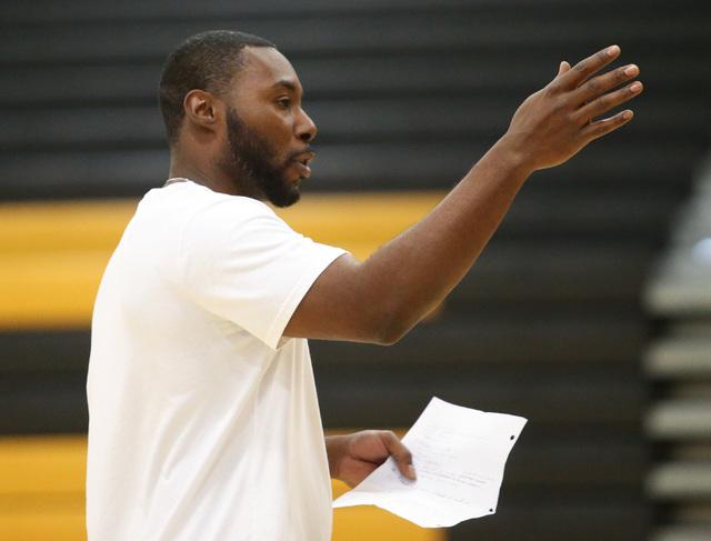 Clark High School basketball head coach Colin Darfour talks to his team during practice at E ...