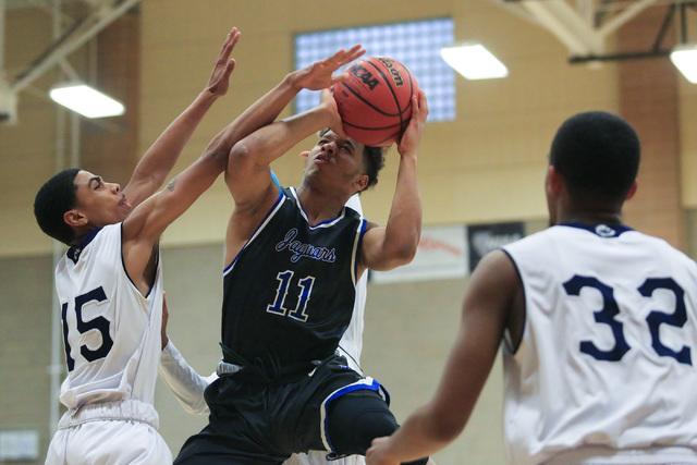 Desert Pines senior Capri Uzan (11) takes a shot during the Class 3A boys regional basketbal ...
