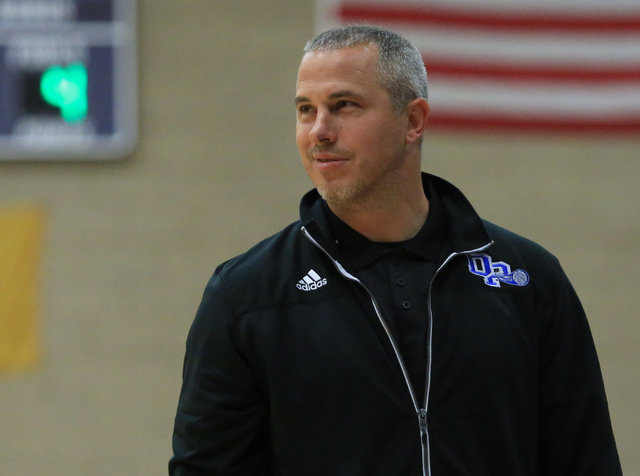 Desert Pines head coach Michael Uzan cracks a smile in the fourth quarter of the Class 3A bo ...