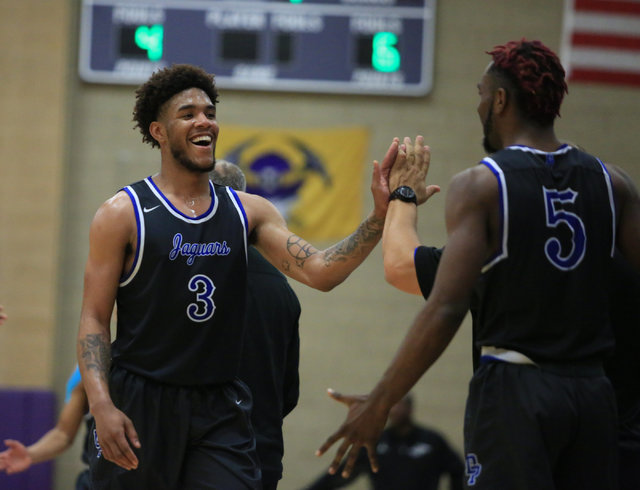 Desert Pines senior Trevon Abdullah (3) smiles as he is pulled off the court in the fourth q ...