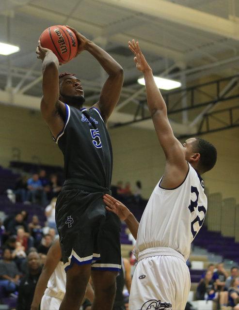 Desert Pines senior Javell Watkins (5) takes a shot during the Class 3A boys regional basket ...