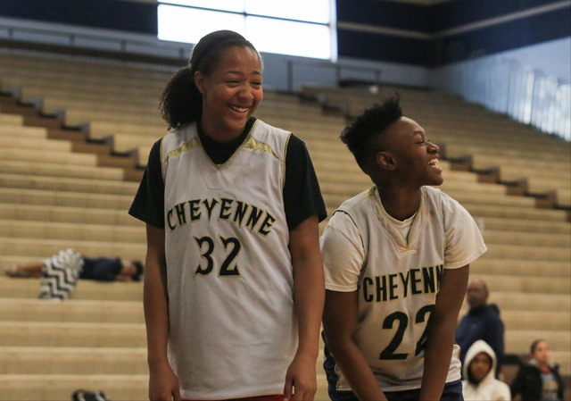 Cheyenne seniors Da'Vione Lomax and Ejanae Coopwood share a laugh during practice at C ...