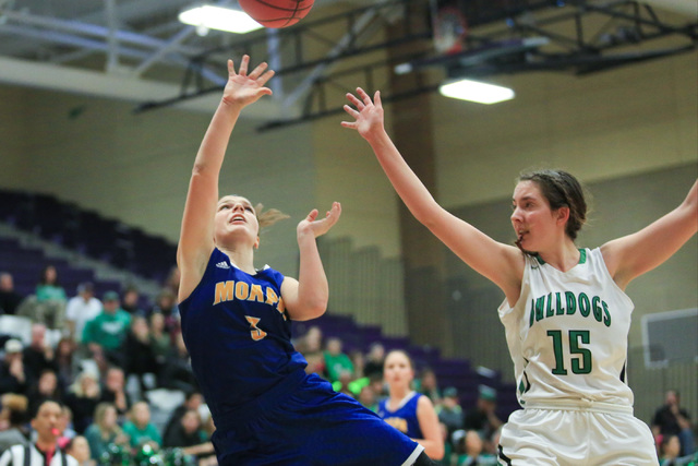 Moapa Valley sophomore Lainey Cornwall (3) shoots the ball during the Class 1A girls regiona ...