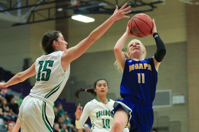Moapa Valley freshman Kaitlyn Anderson (11) shoots the ball during the Class 1A girls region ...