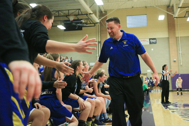 Moapa Valley head coach Stuart Humes high-fives his team before time runs out during the Cla ...