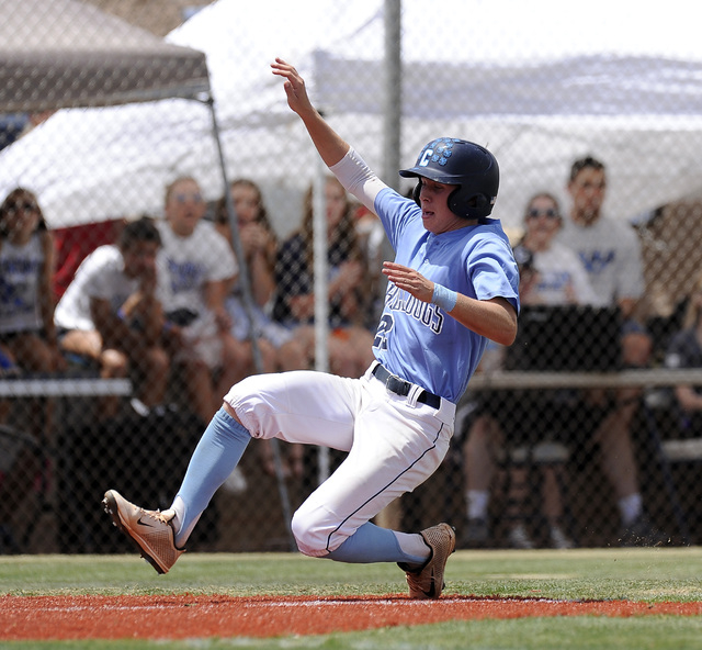 Centennial outfielder Ricky Koplow scores the first run of the game against the Bishop Gorma ...