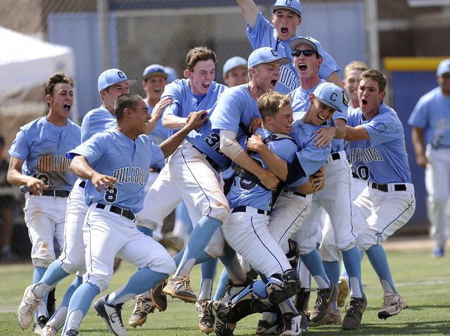 Centennial players celebrate after defeating Bishop Gorman 3-1 in the Sunset Region champion ...