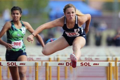 Coronado's Charleen Jordan competes in the girls 100-meter hurdles during the Sunrise ...