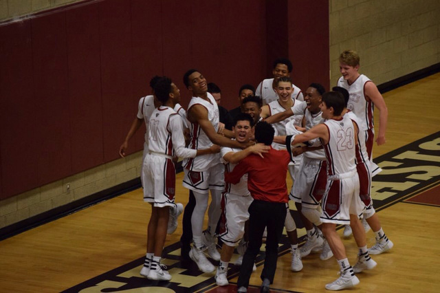 Desert Oasis' Ron Chan is mobbed by teammates after scoring his first points of the se ...