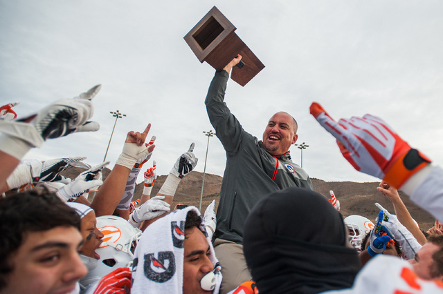 Bishop Gorman head coach Tony Sanchez celebrates the Gaels' 70-28 win over Reed in the ...