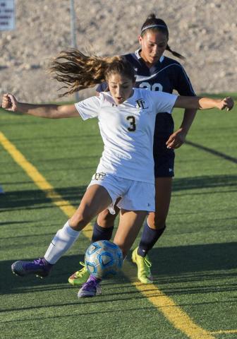 Faith Lutheran defender Isabella Gutierrez (3) dribbles the ball upfield past a Centennial p ...