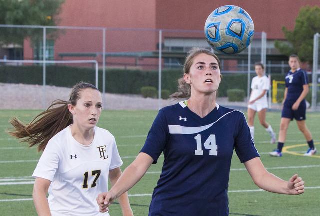 Centennial's McKenna Stratton (14) heads a ball away from Faith Lutheran's Maggi ...