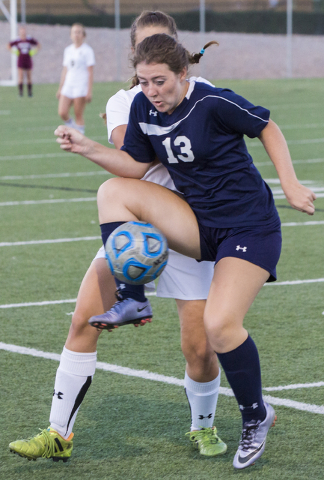Centennial's Shannon Hutchins (13) fights for a loose ball with a Faith Lutheran defen ...