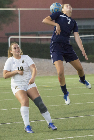 Centennial's Marcella Brooks (7) goes up for a header over Faith Lutheran's Broo ...