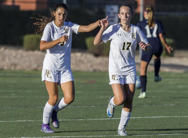 Faith Lutheran's Maggie Shuirman (17) celebrates with teammate Isabella Gutierrez (3) ...