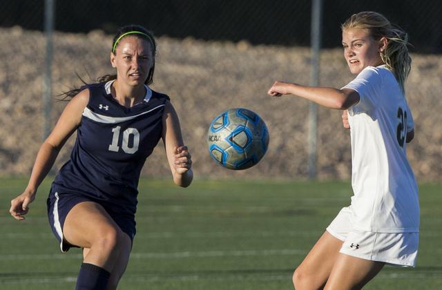 Centennial's Ashton Benson (10) sprints to a loose ball with Faith Lutheran's Am ...