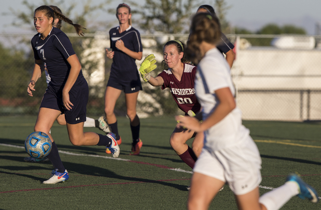 Faith Lutheran's Beka Lescenski (00) clears a ball from the box during her team' ...