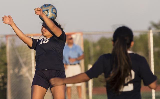 Centennial's Victoria Cera (15) heads a ball out of danger during her team's roa ...