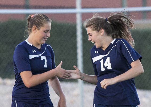 Centennial's Lauren Levoyer (7) and McKenna Stratton (14) celebrate a second half goal ...