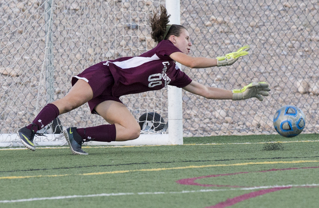 Faith Lutheran's Beka Lescenski (00) makes a diving stop during her team's home ...