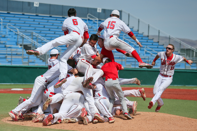The Liberty Patriots celebrate after defeating Centennial 5-3 for the Division I state title ...