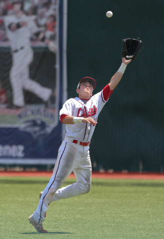 Liberty right fielder Jesse Keiser makes a catch against Centennial in the Division I state ...