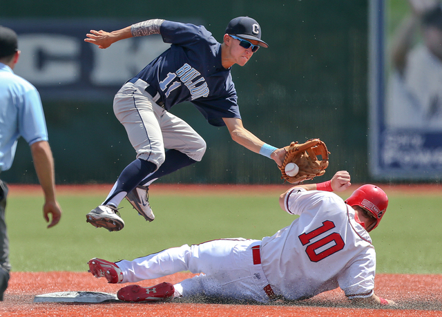 Liberty's Dan Skelly steals safely under the tag of Centennial's Tanner Wright d ...