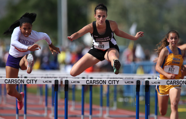 Sunrise Mountain's Brittany Veal, left, runs in the 100-meter hurdles during the Divis ...