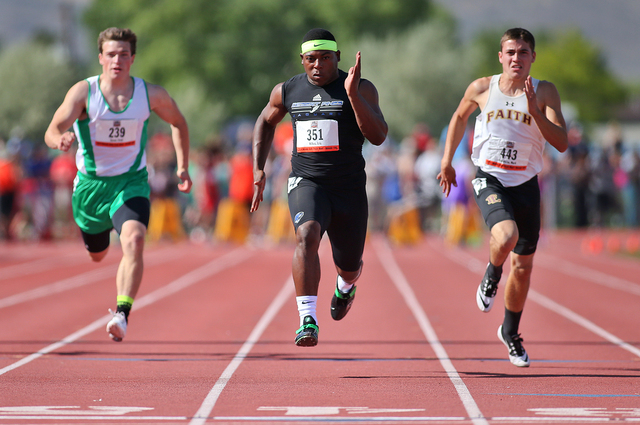Desert Pines' Eric Wilkes, center, wins the Division I-A boys 100-meter dash with a ti ...