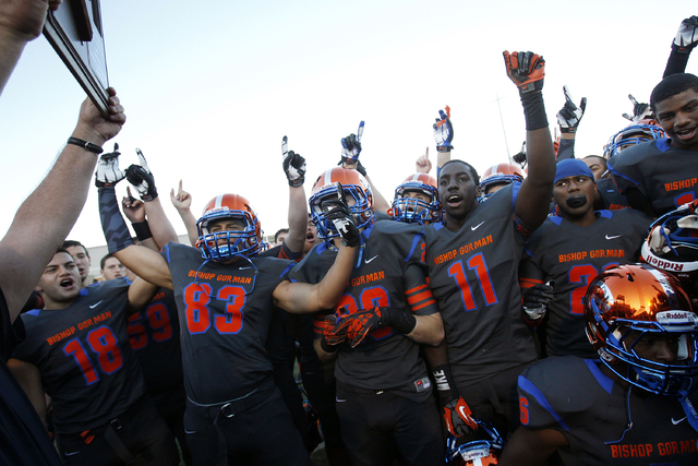 Bishop Gorman players celebrate after defeating Palo Verde 45-7 in the Sunset Region champio ...