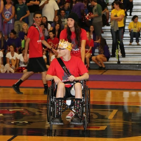 Brooke Lynn Garlick, a senior at Coronado, wheels out Michael Tatalovich at the Homecoming A ...