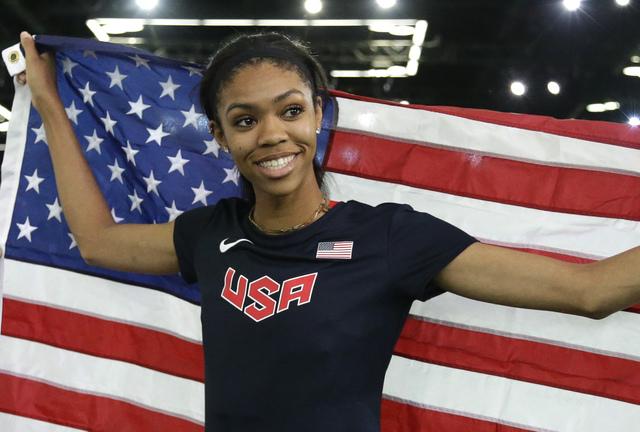 United States' Vashti Cunningham hold the U.S. flag after she won the women's hi ...