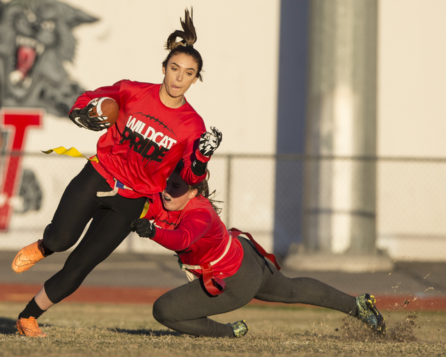 Wildcat wide receiver Natalie Gennuso, left, runs for extra yardage after a catch during fla ...
