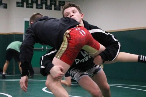 Virgin Valley wrestler Jacob Baird, right, takes down Ty Smith at practice, Virgin Valley Hi ...